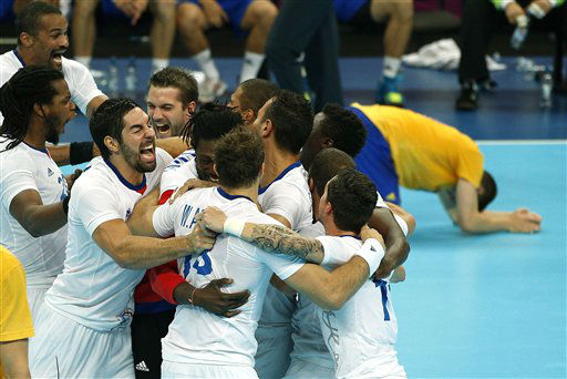 France&#39;s players celebrate winning the gold medal match against Sweden at the 2012 Summer Olympics, Sunday, Aug. 12, 2012, in London. &#40;AP Photo&#47;Vadim Ghirda&#41; <span class=meta>(AP Photo&#47; Vadim Ghirda)</span>