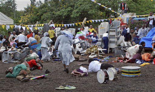 "<div class=""meta ""><span class=""caption-text "">Wounded churchgoers lie on the ground as Roman Catholic nuns run for cover after a blast at the St. Joseph Mfanyakazi Roman Catholic Church in Arusha, Tanzania Sunday, May 5, 2013. A Tanzanian police official says a woman died and over 40 people were seriously injured when a bomb exploded in the Roman Catholic Church in northern Tanzania, with eyewitnesses reporting that the bomb was thrown from a motorcycle. (AP Photo) (AP Photo/ STR)</span></div>"