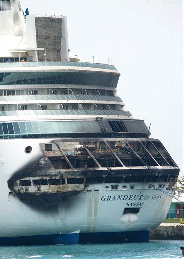 "<div class=""meta ""><span class=""caption-text "">The fire-damaged exterior of Royal Caribbean's Grandeur of the Seas cruise ship is seen while docked in Freeport, Grand Bahama island, Monday, May 27, 2013. Royal Caribbean said the fire occurred early Monday while on route from Baltimore to the Bahamas on the mooring area of deck 3 and was quickly extinguished. All 2,224 guests and 796 crew were safe and accounted for. (AP Photo/The Freeport News, Jenneva Russell) (AP Photo/ Jenneva Russell)</span></div>"