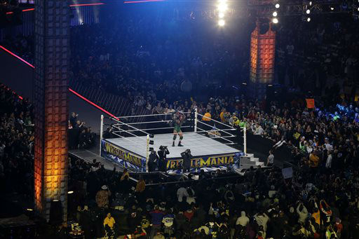 Ryan Reeves, known as Ryback, lifts Mark Henry during their match at the WWE Wrestlemania 29 wrestling event, Sunday, April 7, 2013, in East Rutherford, N.J. &#40;AP Photo&#47;Mel Evans&#41; <span class=meta>(AP Photo&#47; Mel Evans)</span>