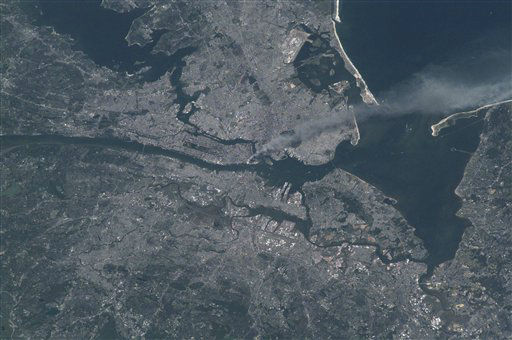 "<div class=""meta ""><span class=""caption-text "">This image provided by NASA shows a smoke plume rising from the Manhattan area after two planes crashed into the towers of the World Trade Center. This photo was taken from the International Space Station of metropolitan New York City (and other parts of New York as well as New Jersey) the morning of Sept. 11, 2001. (AP Photo/NASA, Frank Culbertson) (AP Photo/ Frank Culbertson)</span></div>"