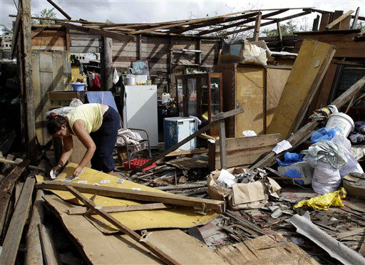 Resident Barbara Garces  tries to recover her belongings from his house destroyed by Hurricane Sandy in Aguacate, Cuba, Thursday Oct. 25, 2012. Hurricane Sandy blasted across eastern Cuba on Thursday as a potent Category 2 storm and headed for the Bahamas after causing at least two deaths in the Caribbean. &#40;AP Photo&#47;Franklin Reyes&#41; <span class=meta>(AP Photo&#47; Franklin Reyes)</span>