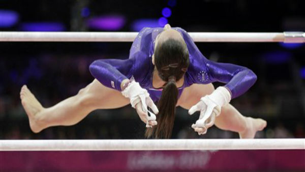 U.S. gymnast Jordyn Wieber performs on the uneven bars during the Artistic Gymnastics women&#39;s qualification at the 2012 Summer Olympics, Sunday, July 29, 2012, in London. &#40;AP Photo&#47;Gregory Bull&#41; <span class=meta>(AP Photo&#47; Gregory Bull)</span>