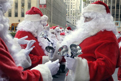 Bells are distributed to Volunteers of America Santas for the 110th annual Sidewalk Santa Parade, in New York,  Friday, Nov. 23, 2012. The donations they raise are used for a holiday food voucher program for needy residents. &#40;AP Photo&#47;Richard Drew&#41; <span class=meta>(AP Photo&#47; Richard Drew)</span>
