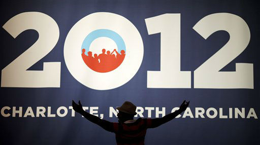 Chris Jones of Charlotte poses in front of the campaign sign as his friend takes a picture at the Democratic National Convention in Charlotte, N.C., on Tuesday, Sept. 4, 2012. &#40;AP Photo&#47;David Goldman&#41; <span class=meta>(AP Photo&#47; David Goldman)</span>