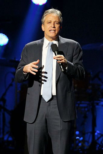 This image released by Starpix shows Jon Stewart at the 12-12-12 The Concert for Sandy Relief at Madison Square Garden in New York on Wednesday, Dec. 12, 2012. Proceeds from the show will be distributed through the Robin Hood Foundation. &#40;AP Photo&#47;Starpix, Dave Allocca&#41; <span class=meta>(AP Photo&#47; Dave Allocca)</span>