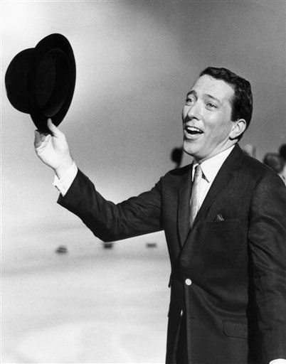 "<div class=""meta ""><span class=""caption-text "">FILE - In a May 12, 1961 file photo, Andy Williams performs a song on a television show. Emmy-winning TV host and ""Moon River"" crooner Williams died Tuesday night, Sept, 25, 2012 at his home in Branson, Mo., following a year-long battle with bladder cancer. He was 84. (AP Photo, File) (AP Photo/ Anonymous)</span></div>"