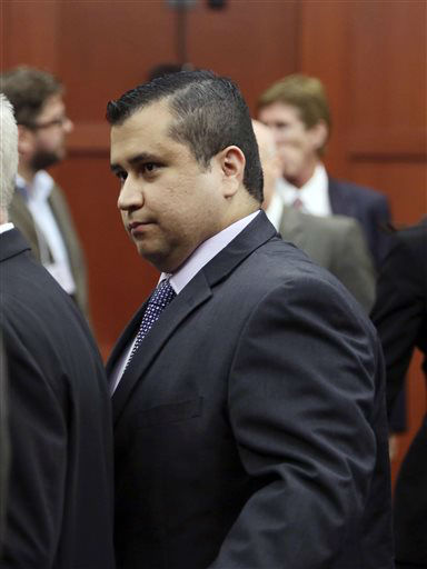 George Zimmerman leaves court with his family after the jury delivered a not guilty verdict in his trial in Seminole Circuit Court in Sanford, Fla. Saturday, July 13, 2013. Zimmerman was charged with second-degree murder for the 2012 shooting death of Trayvon Martin. &#40;AP Photo&#47;Orlando Sentinel, Gary W. Green, Pool&#41; <span class=meta>(AP Photo&#47; Gary W. Green)</span>