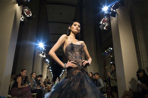 "<div class=""meta ""><span class=""caption-text "">The Zac Posen Spring 2013 collection is modeled during Fashion Week in New York, Sunday, Sept. 9, 2012. (AP Photo/John Minchillo) (AP Photo/ John Minchillo)</span></div>"