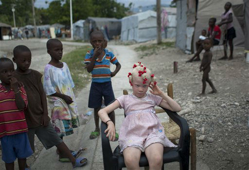 Bernadine Sifoir, 7, front, sits as she poses for pictures at Gaston Margon, a camp for people displaced by the 2010 earthquake, in Port-au-Prince, Haiti, Tuesday, Oct. 9, 2012. &#40;AP Photo&#47;Dieu Nalio Chery&#41; <span class=meta>(AP Photo&#47; Dieu Nalio Chery)</span>