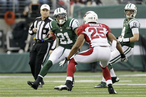 New York Jets running back Kahlil Bell &#40;21&#41; runs with the ball as Arizona Cardinals free safety Kerry Rhodes defends on the play during the second half of an NFL football game, Sunday, Dec. 2, 2012, in East Rutherford, N.J. &#40;AP Photo&#47;Kathy Willens&#41; <span class=meta>(AP Photo&#47; Kathy Willens)</span>