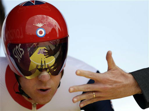 "<div class=""meta ""><span class=""caption-text "">Britain's Bradley Wiggins takes the start of the men's individual time trial cycling event at the 2012 Summer Olympics, Wednesday, Aug. 1, 2012, in London. (AP Photo/Matt Rourke) (AP Photo/ Matt Rourke)</span></div>"
