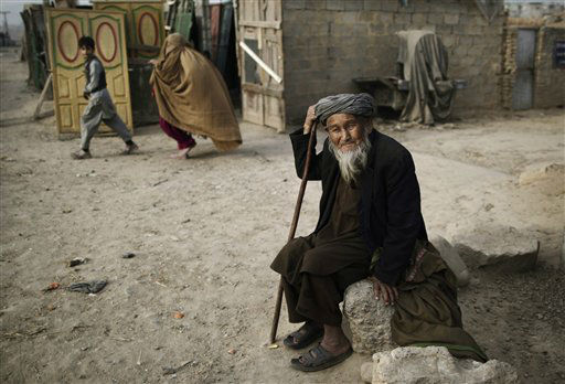 Afghan refugee, Ghulam Mohammed, 95, sits on a roadside next to a poor neighborhood, on the outskirts of Islamabad, Pakistan,Wednesday, Dec. 26, 2012. Ghulam took refuge in Pakistan after fleeing four months ago from Afghanistan&#39;s north-eastern city of Kunduz, due to violence. &#40;AP Photo&#47;Muhammed Muheisen&#41; <span class=meta>(AP Photo&#47; Muhammed Muheisen)</span>