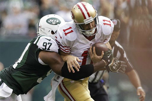 San Francisco 49ers quarterback Alex Smith &#40;11&#41; is sacked by New York Jets outside linebacker Calvin Pace &#40;97&#41; during the first half of an NFL football game Sunday, Sept. 30, 2012, in East Rutherford, N.J. &#40;AP Photo&#47;Kathy Willens&#41; <span class=meta>(AP Photo&#47; Kathy Willens)</span>