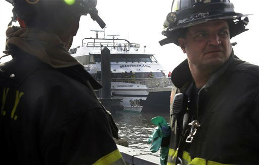 New York City firefighters survey damage to the Seastreak Wall Street ferry in New York,  Wednesday, Jan. 9, 2013. The ferry from Atlantic Highlands, N.J., banged into the mooring as it arrived at South Street in lower Manhattan during morning rush hour, injuring as many as 50 people, at least one critically, officials said.&#40;AP Photo&#47;Richard Drew&#41; <span class=meta>(AP Photo&#47; Richard Drew)</span>