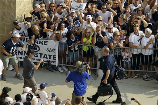 Penn State football fans surround the Penn State football team busses as Penn State head coach Bill O&#39;Brien, center, leads his team into Beaver Stadium for their season opener against Ohio in State College, Pa., Saturday, Sept. 1, 2012. &#40;AP Photo&#47;Gene J. Puskar&#41; <span class=meta>(AP Photo&#47; Gene J. Puskar)</span>
