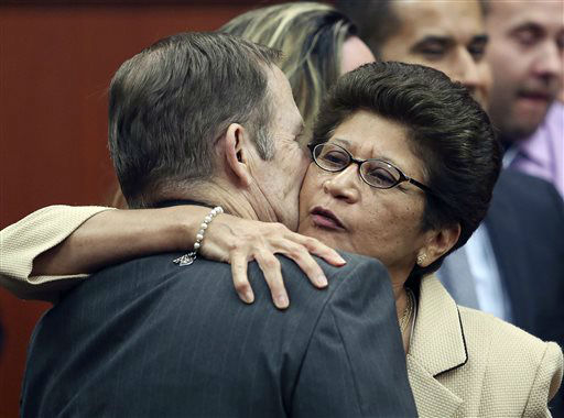 George Zimmerman&#39;s parents Robert Zimmerman Sr. and Gladys Zimmerman embrace following George Zimmerman&#39;s not guilty verdict in Seminole Circuit Court in Sanford, Fla., on Saturday, July 13, 2013. Jurors found Zimmerman not guilty of second-degree murder in the fatal shooting of unarmed 17-year-old Trayvon Martin in Sanford. The six-member, all-woman jury deliberated for more than 15 hours over two days before reaching their decision Saturday night. &#40;AP Photo&#47;Gary W. Green, Pool&#41; <span class=meta>(AP Photo&#47; Gary W. Green)</span>
