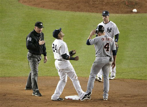 New York Yankees&#39; Robinson Cano, second from left, reacts after umpire Jeff Nelson called Detroit Tigers&#39; Omar Infante safe at second base in the eighth inning of Game 2 of the American League championship series Sunday, Oct. 14, 2012, in New York. New York Yankees&#39; Jayson Nix is at right.  &#40;AP Photo&#47;Charlie Riedel&#41; <span class=meta>(AP Photo&#47; Charlie Riedel)</span>