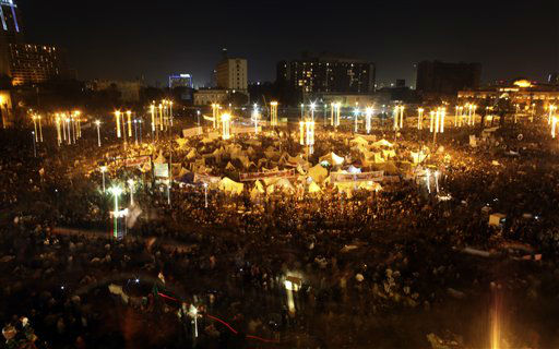 Egyptian protesters attend an opposition rally in Tahrir Square in Cairo, Egypt, Tuesday, Nov. 27, 2012. More than 100,000 people flocked to Cairo&#39;s central Tahrir square on Tuesday, chanting against Egypt&#39;s Islamist president in a powerful show of strength by the opposition demanding Mohammed Morsi revoke edicts granting himself near autocratic powers.&#40;AP Photo&#47;Khalil Hamra&#41; <span class=meta>(AP Photo&#47; Khalil Hamra)</span>