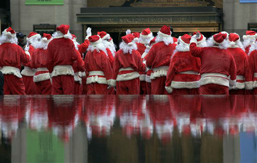 "<div class=""meta image-caption""><div class=""origin-logo origin-image ""><span></span></div><span class=""caption-text"">Volunteers of America Santas are reflected in a fountain during their 110th annual Sidewalk Santa Parade, in New York,  Friday, Nov. 23, 2012. The donations they raise are used for a holiday food voucher program for needy residents. (AP Photo/Richard Drew) (AP Photo/ Richard Drew)</span></div>"