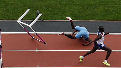 Bahamas&#39;s Shamar Sands falls after hitting a hurdle in the men&#39;s 100-meter hurdles during the athletics in the Olympic Stadium at the 2012 Summer Olympics, London, Tuesday, Aug. 7, 2012. &#40;AP Photo&#47;Morry Gash&#41; <span class=meta>(AP Photo&#47; Morry Gash)</span>
