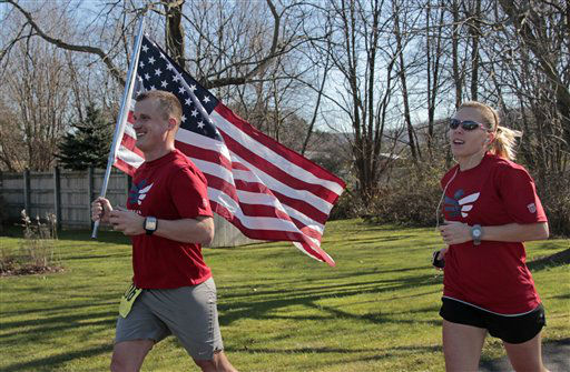 "<div class=""meta ""><span class=""caption-text "">Army Capt. Jim Nemec of West Point, N.Y., left, carries the flag as he runs the Indiana First Bank Veterans Marathon with his wife Lindsey in Dilltown, Pa., on Veterans Day, Sunday, Nov. 11, 2012. Nemec has recently returned from a tour of duty in Afghanistan. (AP Photo/Gene J. Puskar) (AP Photo/ Gene J. Puskar)</span></div>"