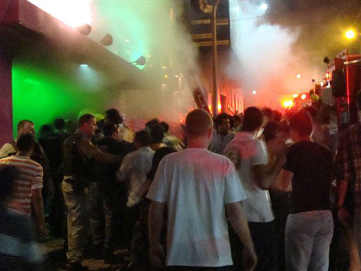 "<div class=""meta ""><span class=""caption-text "">A crowd stands outside the Kiss nightclub during a fire inside the club in Santa Maria city,  Rio Grande do Sul state, Brazil, Sunday, Jan. 27, 2013.  A blaze raced through the crowded nightclub in southern Brazil early Sunday, killing 245 people as the air filled with deadly smoke and panicked party-goers stampeded toward the exits, police and witnesses said. It appeared to be the world's deadliest nightclub fire in more than a decade.(AP Photo/Roger Shlossmacker) (AP Photo/ Roger Shlossmacker)</span></div>"