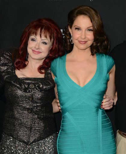 "Naomi Judd, left, and Ashley Judd arrive at the LA premiere of ""Olympus Has Fallen"" at the ArcLight Theatre on Monday, March 18, 2013 in Los Angeles. (Photo by Jordan Strauss/Invision/AP)"