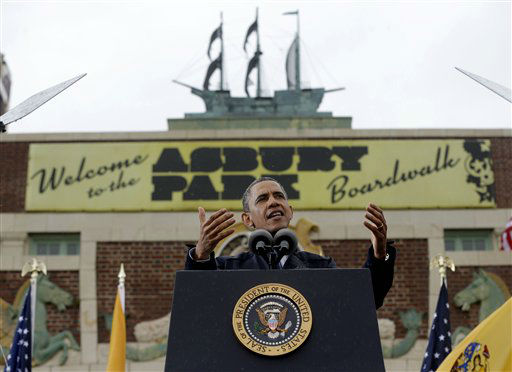 "<div class=""meta ""><span class=""caption-text "">President Barack Obama gestures as he speak outside at Asbury Park Convention Hall ,Tuesday, May 28, 2013 in Asbury Park, New Jersey. Obama traveled to New Jersey to join New Jersey Gov. Chris Christie to inspect and tour the Jersey Shore's recovery efforts from Hurricane Sandy. (AP Photo/Pablo Martinez Monsivais) (AP Photo/ Pablo Martinez Monsivais)</span></div>"