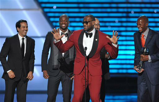 From left, Miami Heat coach Erik Spoelstra and players Dwyane Wade, LeBron James and Ray Allen accept the award for best game at the ESPY Awards on Wednesday, July 17, 2013, at Nokia Theater in Los Angeles. &#40;Photo by John Shearer&#47;Invision&#47;AP&#41; <span class=meta>(Photo&#47;John Shearer)</span>