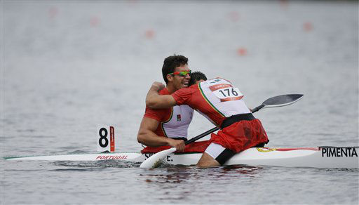 Portugal&#39;s Fernando Pimenta, right, embraces teammate Emanuel Silva after finishing second in the men&#39;s kayak double 1000m in Eton Dorney, near Windsor, England, at the 2012 Summer Olympics, Wednesday, Aug. 8, 2012.  &#40;AP Photo&#47;Chris Carlson, Pool&#41; <span class=meta>(AP Photo&#47; Chris Carlson)</span>