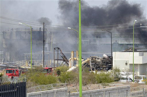 "<div class=""meta image-caption""><div class=""origin-logo origin-image ""><span></span></div><span class=""caption-text"">Smoke rises after an explosion ripped through a gas pipeline distribution center in Reynosa, Mexico near Mexico's border with the United States, Tuesday Sept. 18, 2012. Mexico's state-owned oil company, Petroleos Mexicanos, also known as Pemex said the fire had been extinguished and the pipeline had been shut off but ten people were killed during the incident. (AP Photo/El Manana de Reynosa) (AP Photo/ El Manana de Reynosa)</span></div>"