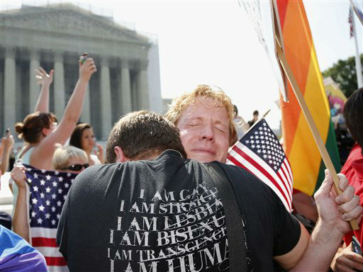 Michael Knaapen, left, and his husband John Becker, right, embrace outside the Supreme Court in Washington, Wednesday, June 26, 2013 after the court struck down a federal provision denying benefits to legally married gay couples. &#40;AP Photo&#47;Charles Dharapak&#41; <span class=meta>(AP Photo&#47; Charles Dharapak)</span>