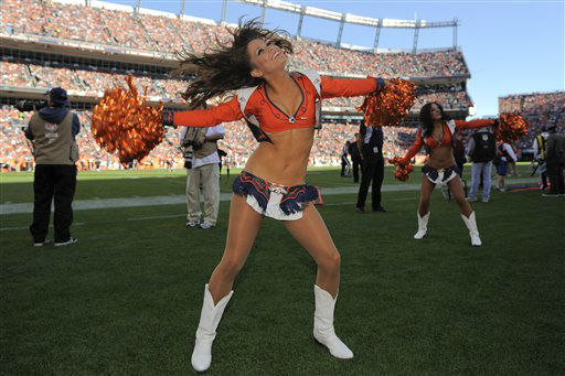 "<div class=""meta ""><span class=""caption-text "">A Denver Broncos cheerleader performs during the first half an NFL football game, Sunday, Dec. 2, 2012, against the Tampa Bay Buccaneers in Denver. (AP Photo/Jack Dempsey) (AP Photo/ Jack Dempsey)</span></div>"