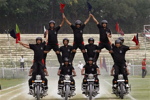 Jammu Kashmir police officers display their skills on motorcycles during a rehearsal for the Indian Independence Day celebrations in Srinagar, India, Monday, Aug. 13, 2012. India celebrates its 1947 independence from British colonial rule on Aug. 15. &#40;AP Photo&#47;Mukhtar Khan&#41; <span class=meta>(AP Photo&#47; Mukhtar Khan)</span>