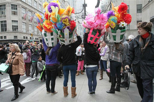 Wearing Easter gardens on their heads, the Woram sisters, from Toms River, N.J., seen from behind, pose for photographs on New York&#39;s Fifth Avenue as they take part in the Easter Parade Sunday March 31, 2013. <span class=meta>(AP Photo&#47; Tina Fineberg)</span>
