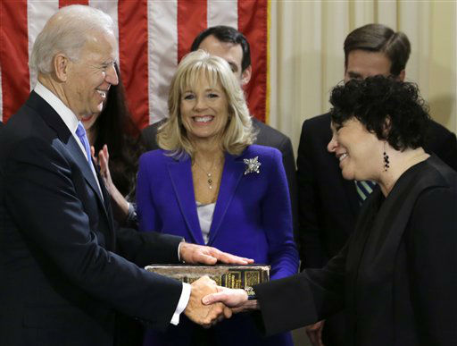 Vice President Joe Biden, with his wife Jill Biden, center, holding the Biden Family Bible, shakes hands with Supreme Court Justice Sonia Sotomayor after taking the oath of office during an official ceremony at the Naval Observatory, Sunday, Jan. 20, 2013, in Washington. &#40;AP Photo&#47;Carolyn Kaster&#41; <span class=meta>(AP Photo&#47; Carolyn Kaster)</span>