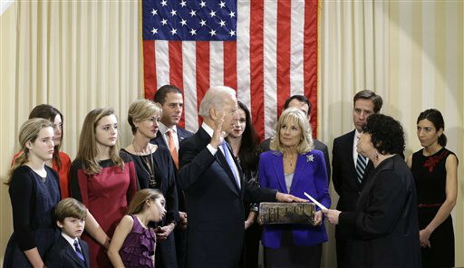 "<div class=""meta ""><span class=""caption-text "">Vice President Joe Biden, with his wife Jill Biden holding the Biden Family Bible, takes the official oath of office from Supreme Court Justice Sonia Sotomayor, surrounded by family, during an official ceremony at the Naval Observatory, Sunday, Jan. 20, 2013, in Washington.   Family members from left: Maisy Biden, R. Hunter Biden, Noami Biden, Finnegan Biden, Natalie Biden, Kathleen Biden, Hunter Biden, Ashley Biden, Howard Krein, Beau Biden, Hallie Biden. (AP Photo/Carolyn Kaster) (AP Photo/ Carolyn Kaster)</span></div>"