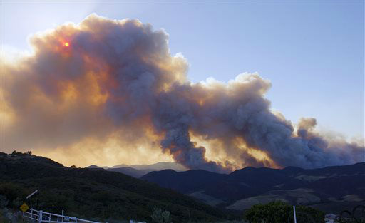 "<div class=""meta image-caption""><div class=""origin-logo origin-image ""><span></span></div><span class=""caption-text"">Smoke billows from a fire burring in Point Mugu State Park during a wildfire that burned several thousand acres, Thursday, May 2, 2013, in Ventura County, Calif.   (AP Photo/Mark J. Terrill) (AP Photo/ Mark J. Terrill)</span></div>"