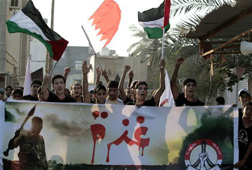 Bahrainis chant anti-Israeli slogans as they wave Palestinian Bahraini flags Bani Jamra, Bahrain, west of the capital of Manama, Sunday, Nov. 18, 2012. Marchers, defying a government ban on protests, also chanted against the United States and the Bahraini government. The banner, center, reads, in Arabic, &#34;Gaza,&#34; and the logo of the Bahraini anti-government group February 14, at right, reads, &#34;steadfastness, resistance.&#34; &#40;AP Photo&#47;Hasan Jamali&#41; <span class=meta>(AP Photo&#47; Hasan Jamali)</span>