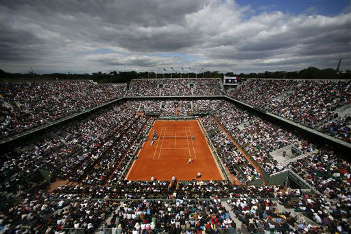 The crowd watches France&#39;s Jo-Wilfried Tsonga playing Serbia&#39;s Viktor Troicki, foreground, on center court during their fourth round match of the French Open tennis tournament at the Roland Garros stadium Sunday, June 2, 2013 in Paris. &#40;AP Photo&#47;Petr David Josek&#41; <span class=meta>(AP Photo&#47; Petr David Josek)</span>