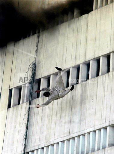 "<div class=""meta ""><span class=""caption-text "">A man jumps from the fifth floor of a building that caught on fire in Lahore, Pakistan, Thursday, May 9, 2013. The 13-storey government building caught fire and quickly intensified spreading to three floors of the tall building. (AP Photo/K.M. Chaudary) </span></div>"