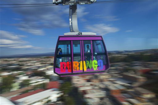 People ride on the aerial tramway in the city of Durango, Mexico, Wednesday, June 12, 2013. &#40;AP Photo&#47;Dario Lopez-Mills&#41; <span class=meta>(AP Photo&#47; Dario Lopez-Mills)</span>