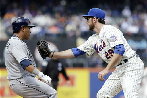 New York Mets first baseman Ike Davis &#40;29&#41; tags out San Diego Padres shortstop Everth Cabrera &#40;2&#41; during the first inning of an opening day baseball game Monday, April 1, 2013, in New York. &#40;AP Photo&#47;Frank Franklin II&#41; <span class=meta>(AP Photo&#47; Frank Franklin II)</span>