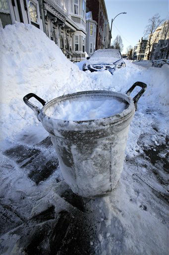 A trash can marks the cleared out parking spot of a resident on M street in the South Boston neighborhood of Boston early Sunday, Feb. 10, 2013 in Boston. &#40;AP Photo&#47;Gene J. Puskar&#41; <span class=meta>(AP Photo&#47; Gene J. Puskar)</span>