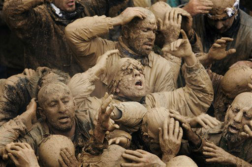 Iranian mourners cover themselves with mud, during Ashoura, marking the death anniversary of Imam Hussein, the grandson of Islam&#39;s Prophet Muhammad, at the city of Bijar, west of the capital Tehran, Iran, Sunday, Nov. 25, 2012. Hussein, one of Shiite Islam&#39;s most beloved saints, was killed in a 7th century battle at Karbala, Iraq. &#40;AP Photo&#47;Vahid Salemi&#41; <span class=meta>(AP Photo&#47; Vahid Salemi)</span>