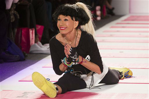 Designer Betsey Johnson greets the audience with her trademark cartwheel and split following a showing of her Fall 2013 collection during Fashion Week in New York, Monday, Feb. 11, 2013. &#40;AP Photo&#47;John Minchillo&#41; <span class=meta>(AP Photo&#47; John Minchillo)</span>