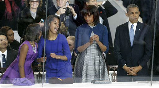 "<div class=""meta ""><span class=""caption-text "">President Barack Obama, right, and first lady Michelle Obama watch the Inaugural parade down Pennsylvania Avenue as their daughters, Sasha, left, and Malia, second from left, dance in the presidential box near the White House, Monday, Jan. 21, 2013, in Washington. Thousands  marched during the 57th Presidential Inauguration parade after the ceremonial swearing-in of President Barack Obama. (AP Photo/Gerald Herbert) (AP Photo/ Gerald Herbert)</span></div>"