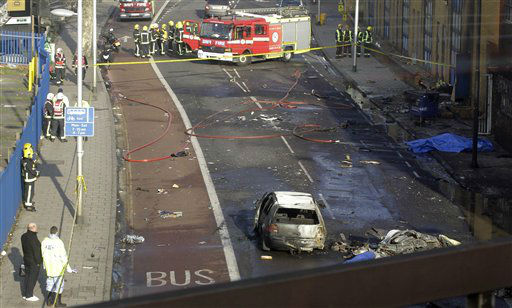 Remnants of a helicopter which crashed onto a construction crane is seen on the ground by a burnt out car in London, Wednesday, Jan. 16, 2013.  The helicopter crashed into a crane and fell on a crowded street in central London during rush hour Wednesday, sending black plumes of smoke into the air as it smashed to the ground. The pilot and one person on the ground were killed and 13 others injured, officials said. &#40;AP Photo&#47;Sang Tan&#41; <span class=meta>(AP Photo&#47; Sang Tan)</span>