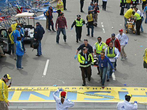 Medical workers wheel the injured across the finish line during the 2013 Boston Marathon following an explosion in Boston, Monday, April 15, 2013. Two explosions shattered the euphoria of the Boston Marathon finish line on Monday, sending authorities out on the course to carry off the injured while the stragglers were rerouted away from the smoking site of the blasts. &#40;AP Photo&#47;Charles Krupa&#41; <span class=meta>(AP Photo&#47; Charles Krupa)</span>